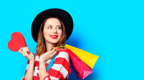 Woman with heart shape toy and shopping bags Royalty Free Stock Photo