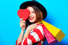 Woman with heart shape toy and shopping bags Royalty Free Stock Photography