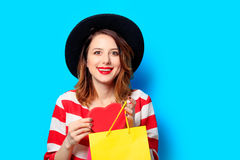 Woman with heart shape toy and shopping bags Stock Images