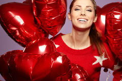 Woman with a heart-shaped balloons Royalty Free Stock Images
