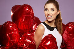 Woman with a heart-shaped balloons Stock Photos