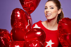 Woman with a heart-shaped balloons Stock Photography