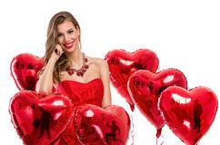 Woman with a heart-shaped balloons Royalty Free Stock Photo