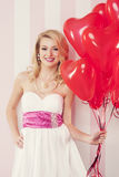 Woman with heart shaped balloons Royalty Free Stock Photos