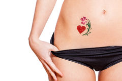 Woman with heart shaped glitter-tattoo isolated Stock Photo