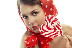 Woman with heart shaped lollipop Stock Images