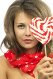 Woman with heart shaped lollipop Stock Image