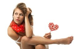 Woman with heart shaped lollipop Stock Photography