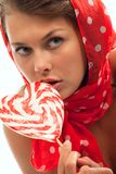 Woman with heart shaped lollipop Royalty Free Stock Images