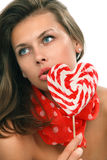 Woman with heart shaped lollipop Royalty Free Stock Photo