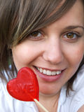 Woman with heart-shaped lollipop Stock Photo