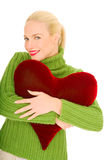 Woman with heart-shaped pillow Royalty Free Stock Images