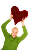 Woman with heart-shaped pillow Royalty Free Stock Image