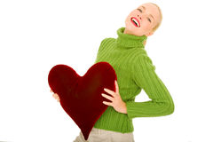 Woman with heart-shaped pillow Stock Photo