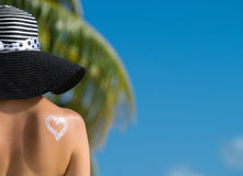 Woman with heart shaped sun cream. Vacation holidays. Maldives Royalty Free Stock Images