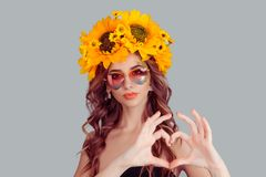 Woman in heart shaped sunglasses howing heart symbol with hands royalty free stock photos