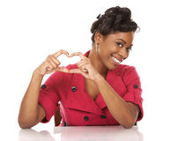Woman and heart sign Royalty Free Stock Photography