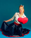Woman heart Valentine's Day. Woman holding a big heart on Valentine's Day Royalty Free Stock Photos