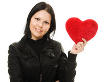 Woman with a heart on a white background. Royalty Free Stock Images