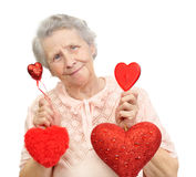 Woman with hearts. Senior woman with many different hearts Royalty Free Stock Photo