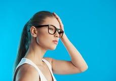 Woman heaving headache Stock Photos