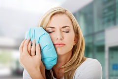 Woman heaving tooth ache Stock Photography