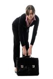 Woman with heavy briefcase Royalty Free Stock Photography