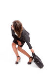 Woman with heavy briefcase Royalty Free Stock Photo
