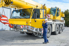 Woman with heavy equipment. Woman with a heavy equipment stock photos