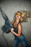 Woman with heavy perforator. Beautiful blond woman with heavy perforator in her hands Stock Photo