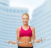 Woman with heavy steel dumbbells Stock Image