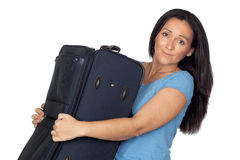 Woman with a heavy suitcase Royalty Free Stock Photos