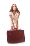 Woman with a heavy suitcase, isolated on white Stock Photos