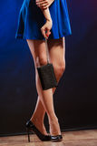 Woman in heels holds handbag, disco club Royalty Free Stock Images