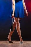 Woman in heels holds handbag, disco club Stock Photo