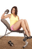 Woman in heels on weight bench Stock Image