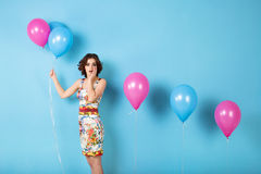 Woman with helium air balloons. Royalty Free Stock Images