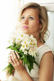 Woman with a hellebore Stock Image