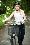 Woman in helmet on bicycle trip Royalty Free Stock Images