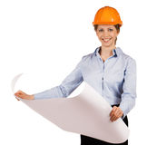 Woman in helmet with a detailed plan Stock Photo