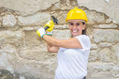 Woman with helmet and hammer Stock Images