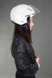 Woman with helmet on head Stock Photo