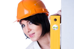 Woman in helmet with level Royalty Free Stock Image