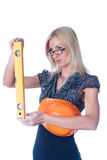 Woman in helmet with level Stock Photography