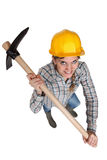 Woman with a helmet and pickaxe Stock Photo