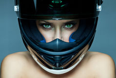 Woman in helmet. Sexy woman in helmet on blue background Stock Image