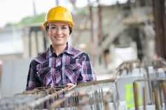 Woman with helmet and tools construction. Woman with helmet and tools of construction Stock Image