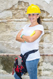 Woman with helmet and tools of construction Royalty Free Stock Photos