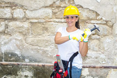 Woman with helmet and tools of construction Royalty Free Stock Photography