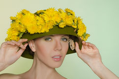 Woman in  helmet with a wreath of dandelions Royalty Free Stock Image
